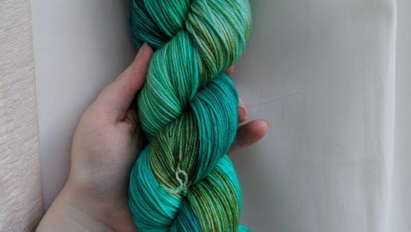 a skein of blue green yarn